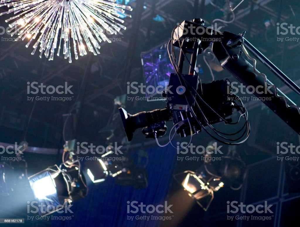 TV camera on a crane in the studio stock photo