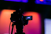 Silhouette of a TV Camera filming a live broadcast