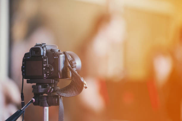 camera on a tripod indoor with beautiful blured background stock photo