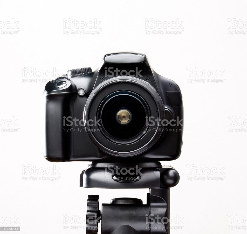 SLR camera on a tripod stock photo