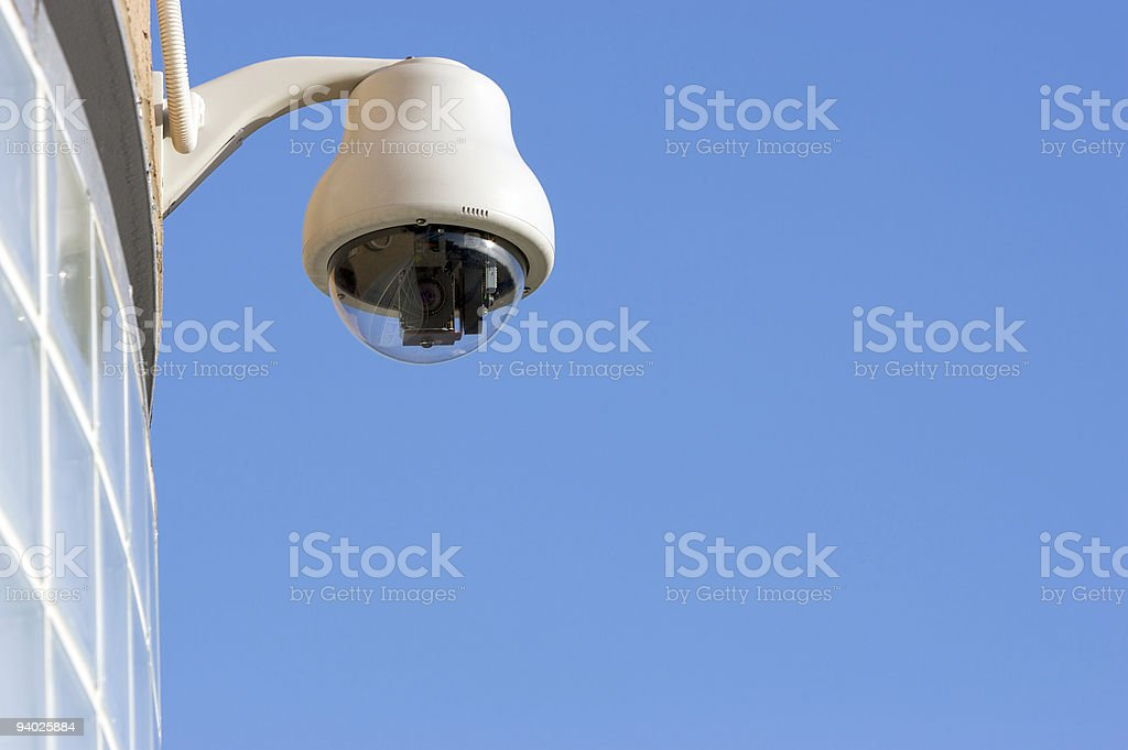 CCTV camera on side of building royalty-free stock photo