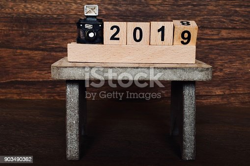 istock Camera on table and 2019 903490362