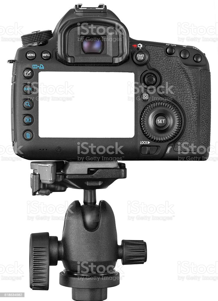 DSLR camera on tripod isolated on white stock photo