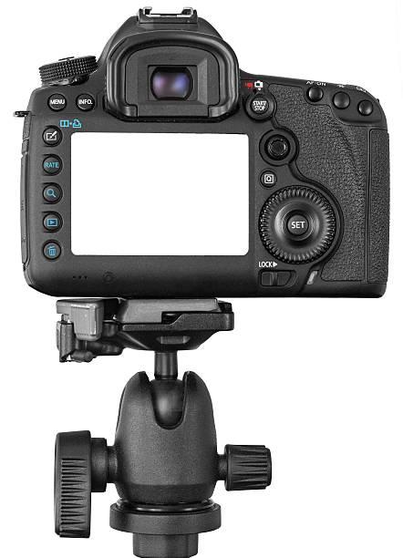 DSLR camera on tripod isolated on white stock photo