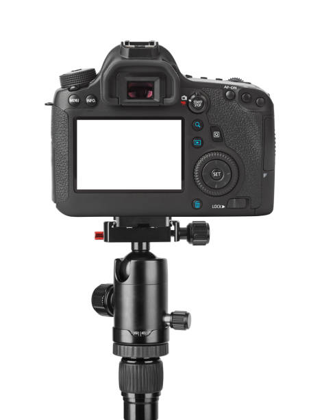 Camera on tripod stock photo