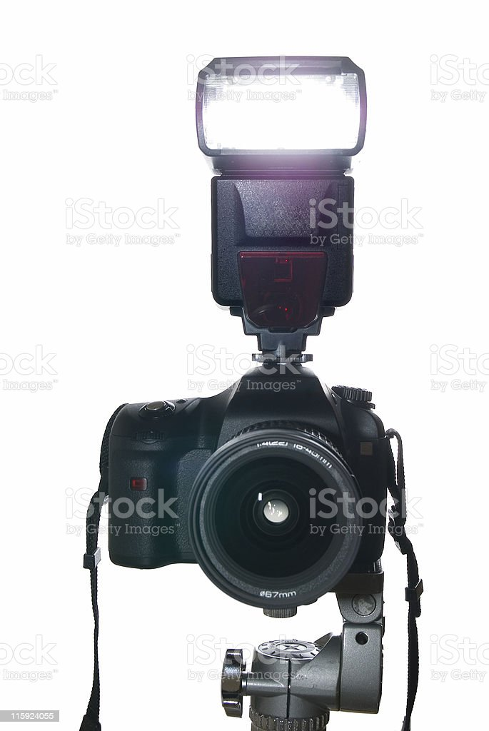 SLR camera on tripod with flash firing royalty-free stock photo