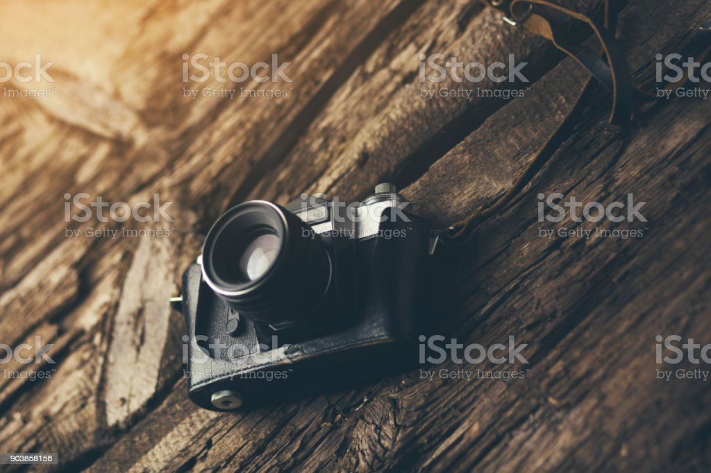 camera on wood table background stock photo