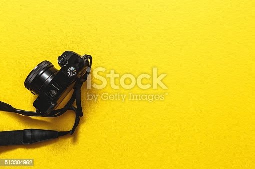 Camera on yellow background.