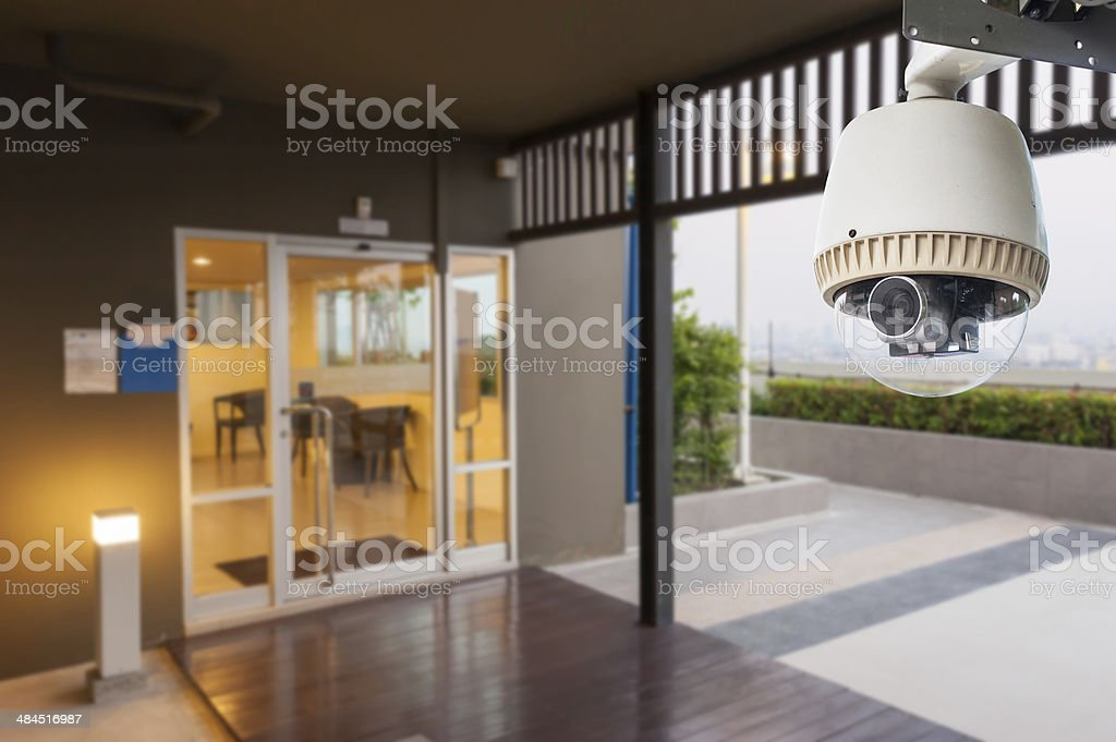 CCTV Camera Operating with door stock photo