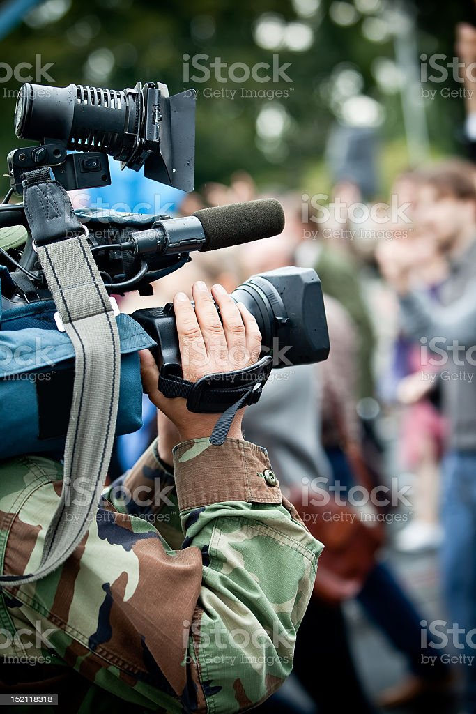Camera operator recording crowd stock photo