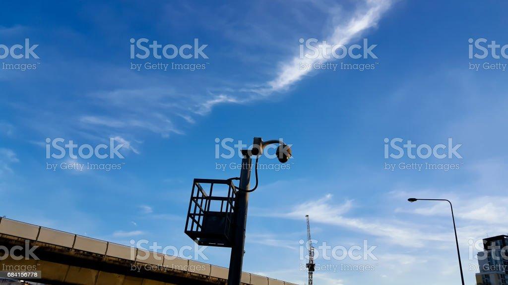 CCTV camera or surveillance operaiting on blue sky zbiór zdjęć royalty-free