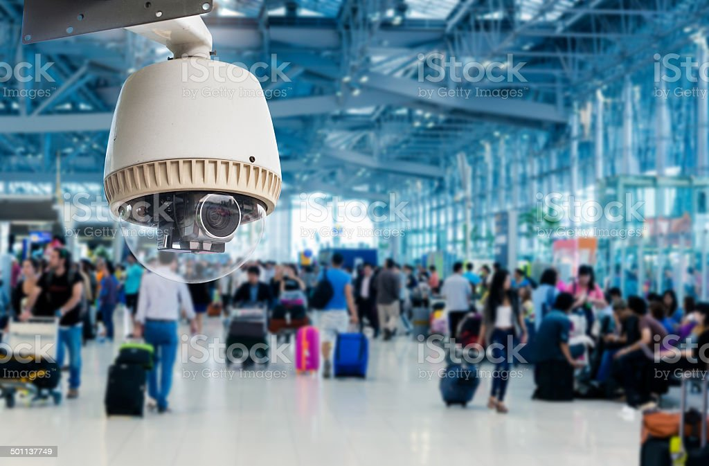 CCTV camera or surveillance operating in air port stock photo