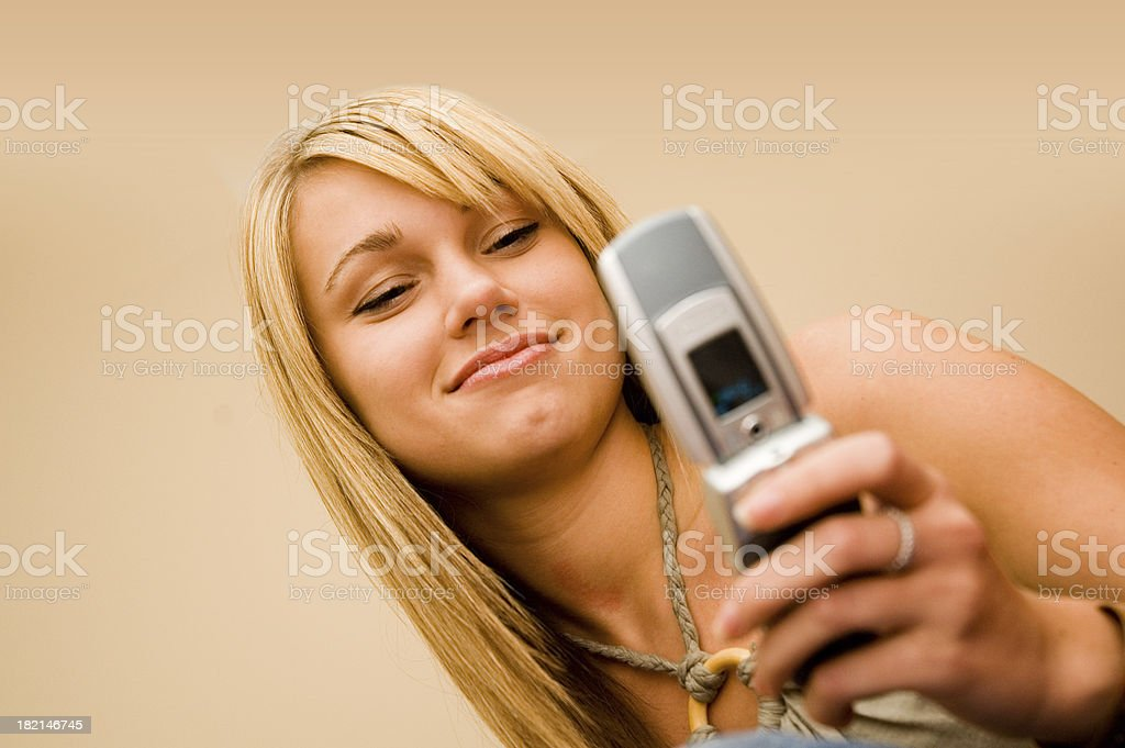 Camera Phone (Young Woman in Focus) stock photo