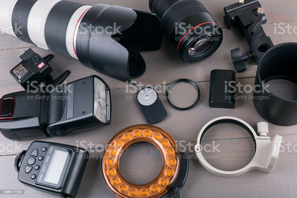camera photo lenses and equipment on wooden background stock photo