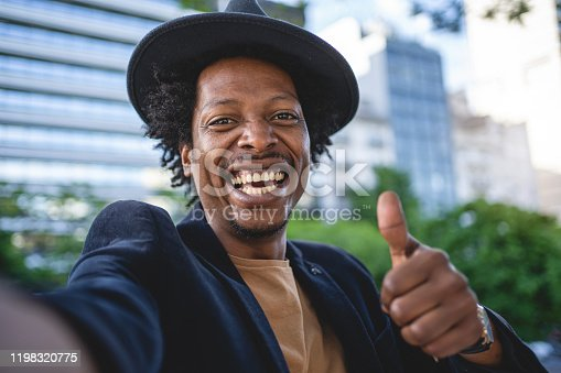 African American man exploring Buenos Aires and taking selfies