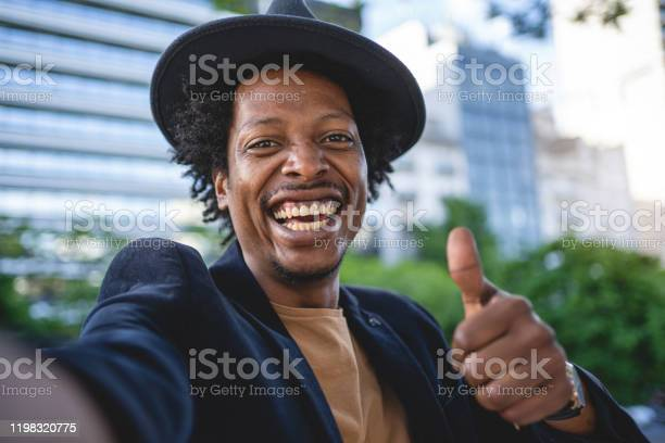 Camera Point Of View Of An African American Man Holding Thumbs Up Stock Photo - Download Image Now