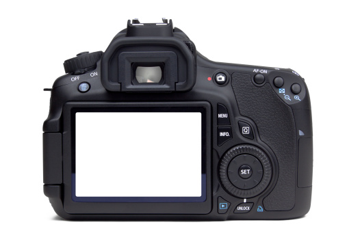 A rear view closeup of a DSLR camera isolated on a white background. Add your own photo.