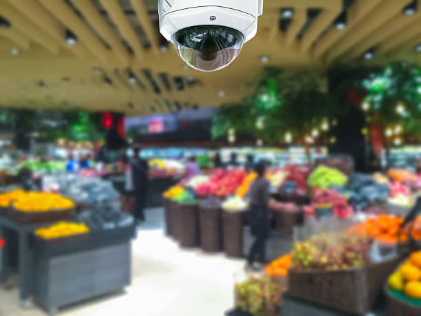 CCTV camera security in shopping mall with supermarket blur back​​​ foto