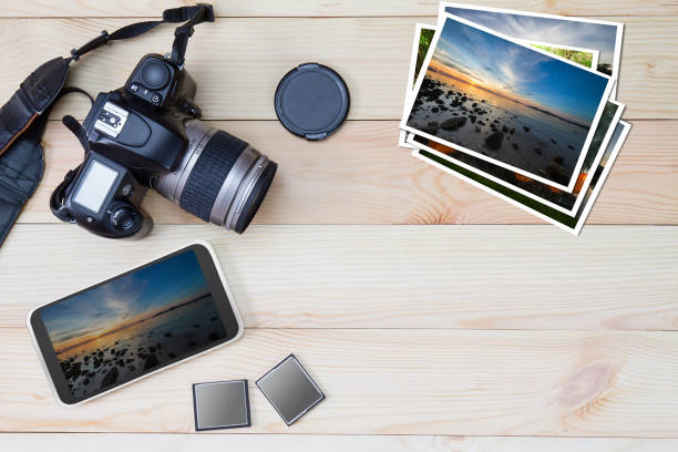dslr camera, smartphone, photos and memory card on wooden background - memory card stock photos and pictures