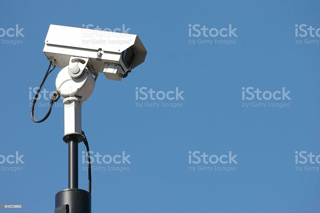 CCTV camera watching criminals royalty-free stock photo