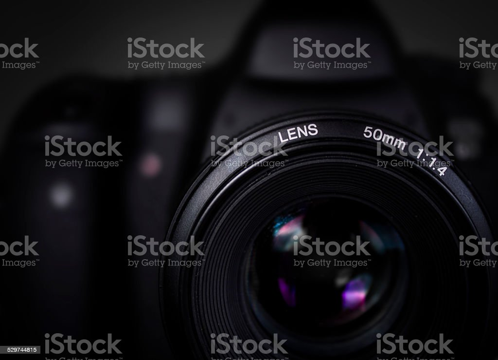 DSLR camera with 50mm lens. stock photo
