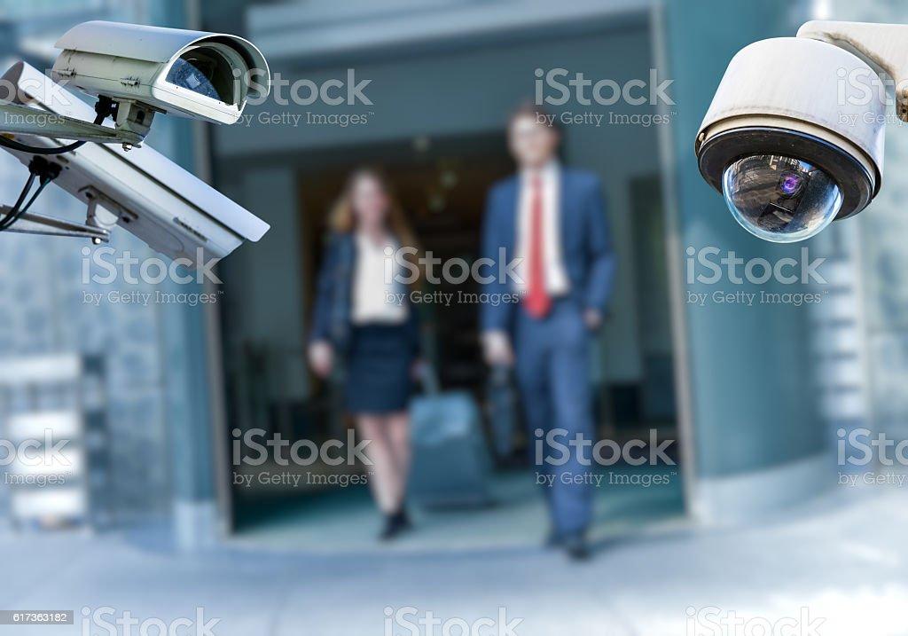 CCTV camera with airport area and people - foto de acervo