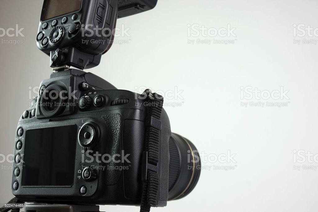 DSLR camera with external flash stock photo