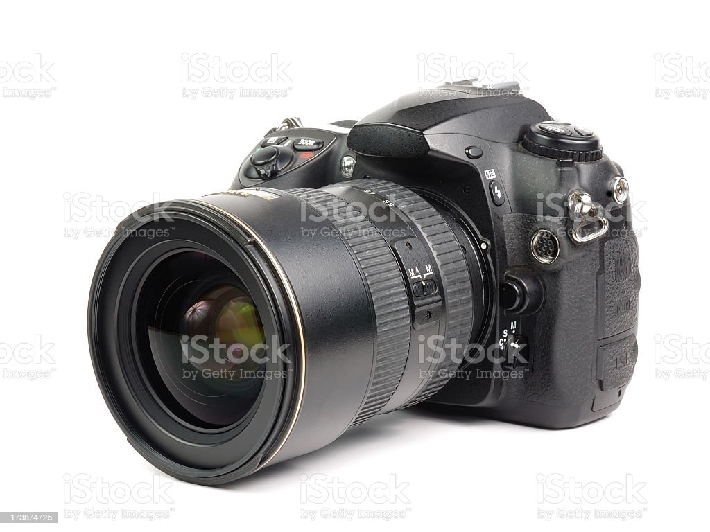 Camera with zoom lens on white background stock photo