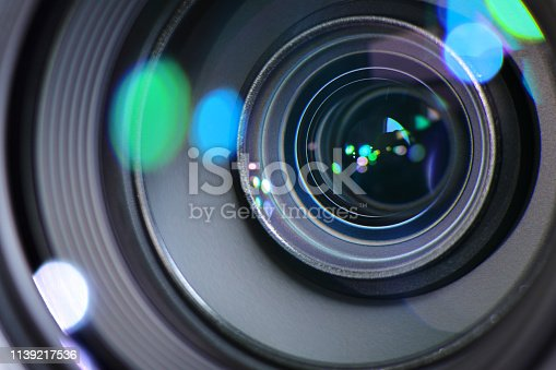 Camera zoom lens zooming in and out to focus a sharp image and to capture a photograph or video
