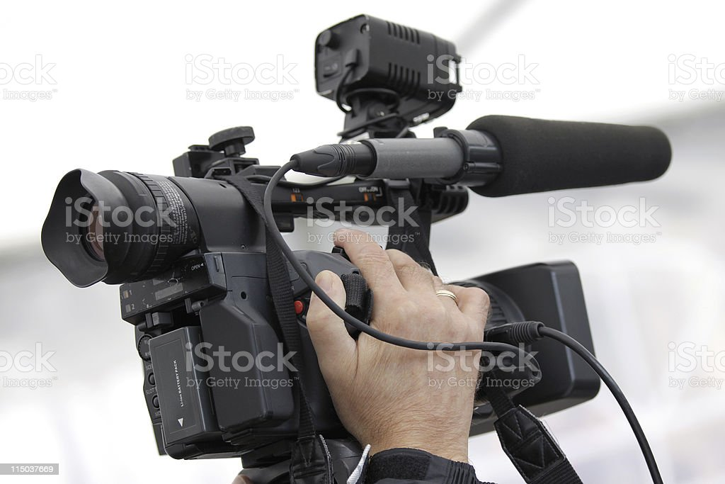 Cameraman and video camera royalty-free stock photo