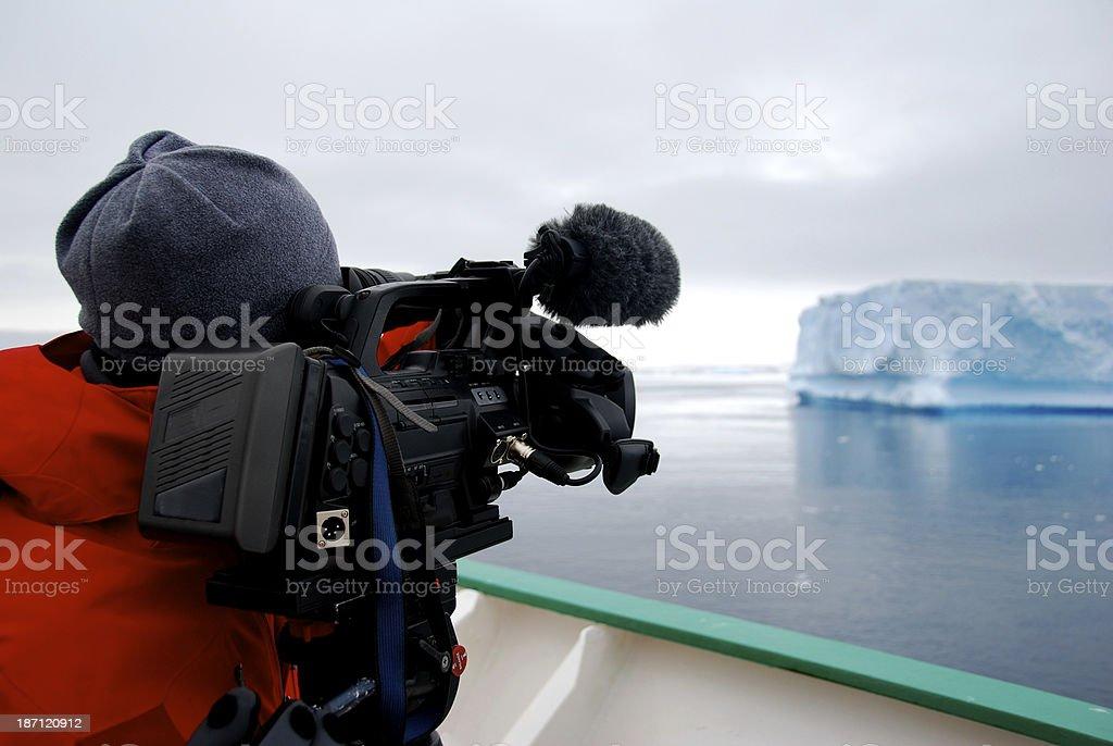 cameraman filming an iceberg stock photo