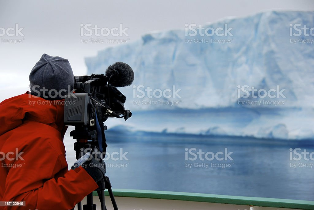 cameraman filming an iceberg stock photo