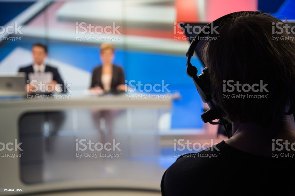 Cameraman filming stock photo