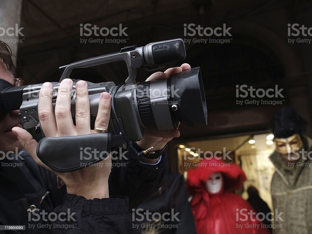 Cameraman getting video on Venice carnival royalty-free stock photo