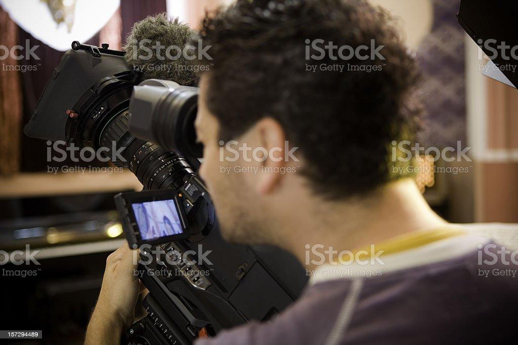 Cameraman in action stock photo