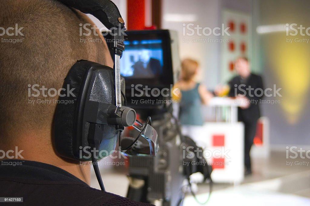 Cameraman in TV studio stock photo
