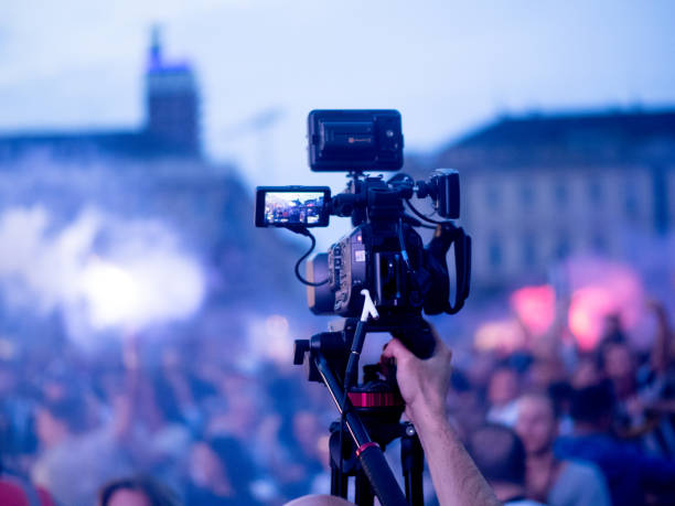 Cameraman Live tv broadcasting crowd in the street stock photo