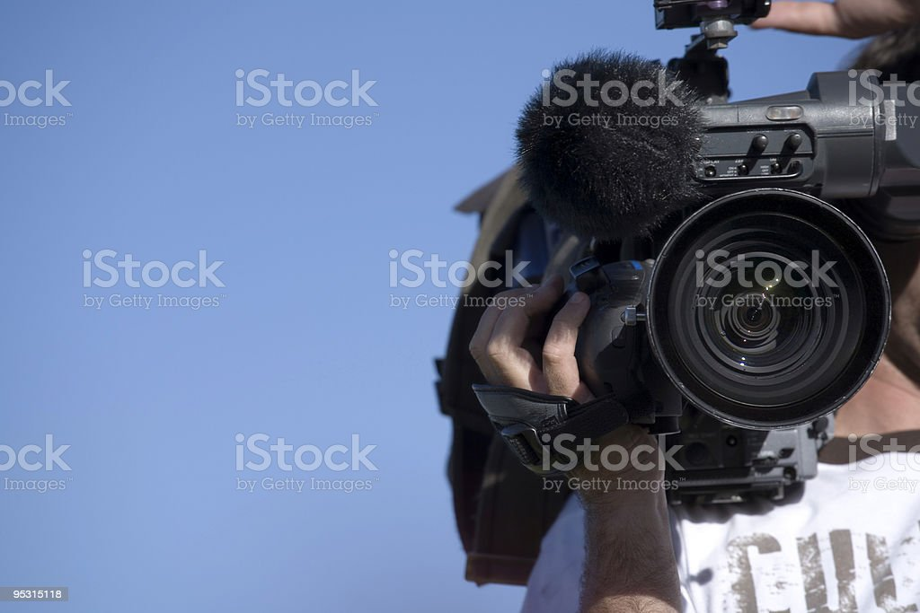 Cameraman outdoors at work royalty-free stock photo