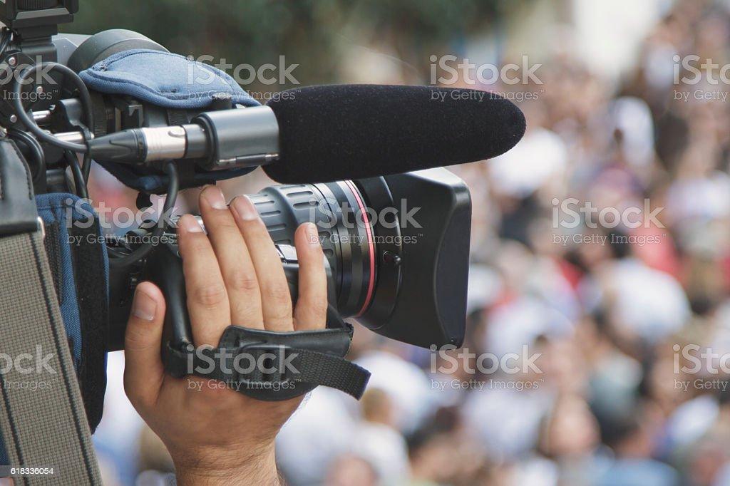 Cameraman shooting crowd stock photo