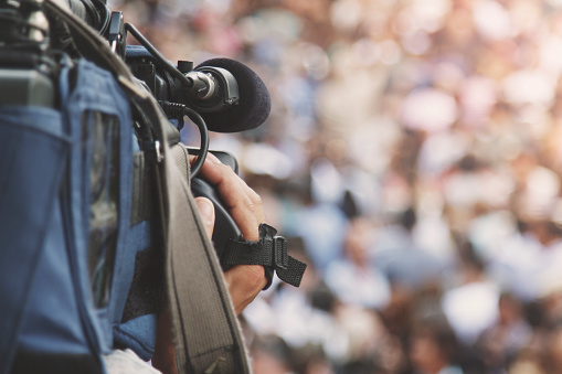 Cameraman Shooting Crowd Stock Photo - Download Image Now
