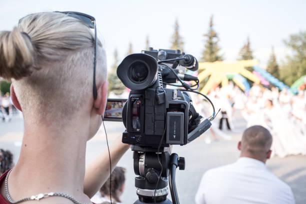 Cameraman working on professional camera taking film outdoors in the picture id1273278913?b=1&k=6&m=1273278913&s=612x612&w=0&h=hhht1vpbwrlfjejzvpq2x ijo21rjt7q1yigv2zr4v8=