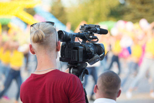 Cameraman working on professional camera taking film outdoors in the picture id1273278915?b=1&k=6&m=1273278915&s=612x612&w=0&h=6zm6 gnuzixjeauutpflqyi uigger2tg79o6u2y1hm=