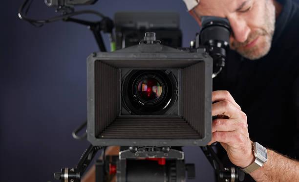 cameraman working with a cinema camera stock photo