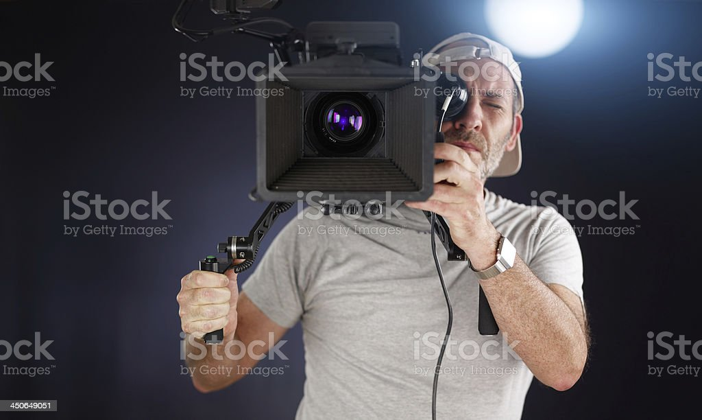 cameraoperator working with a moviecamera royalty-free stock photo