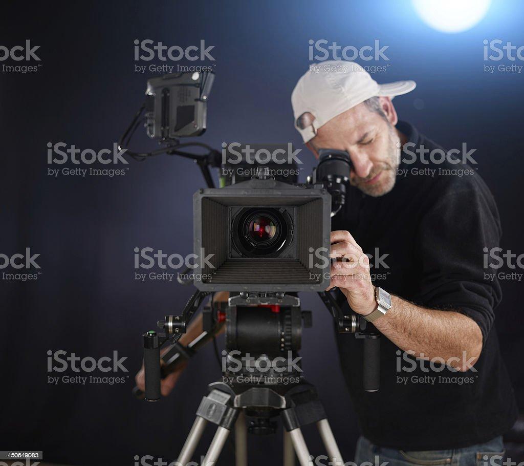 cameraoperator works with a cinema camera stock photo
