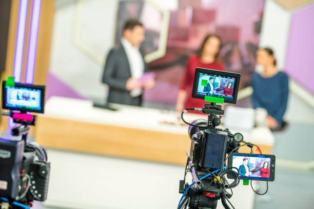 Cameras filming a television talk show stock photo