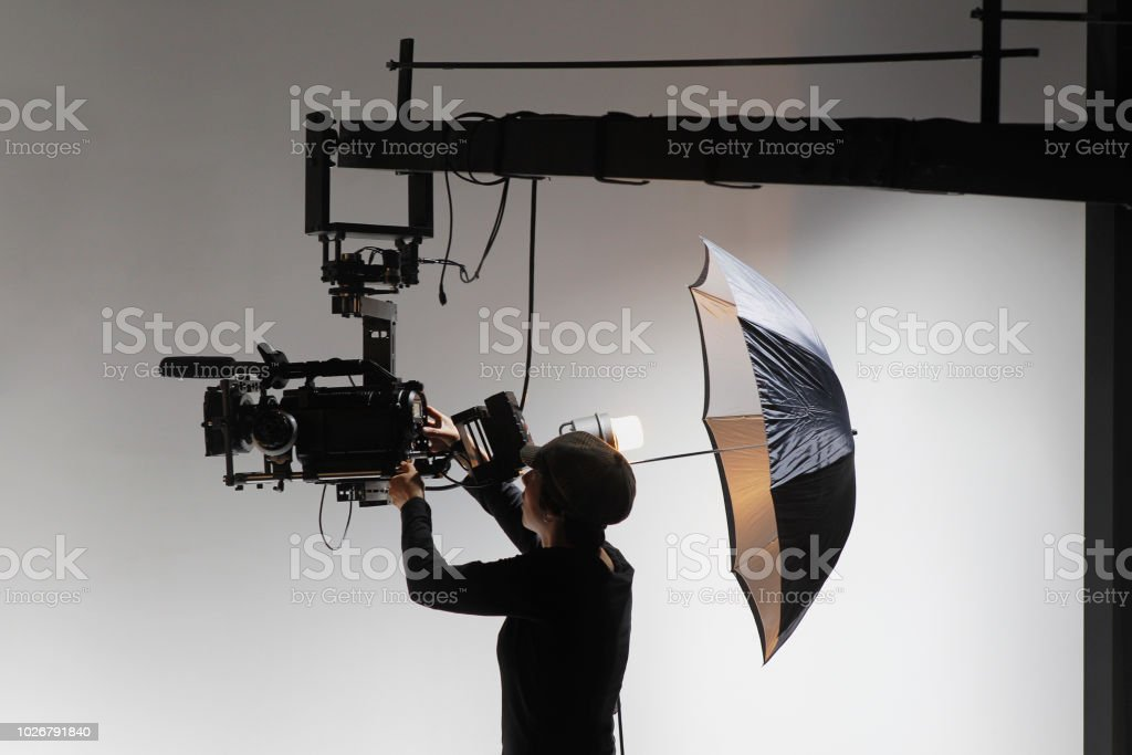 Camerawoman Behind the Scenes on a Film Set stock photo