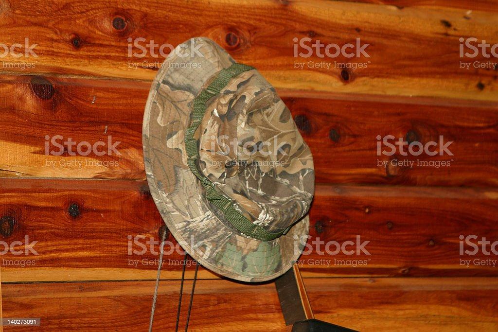 Camo Hat & Cedar Wall stock photo