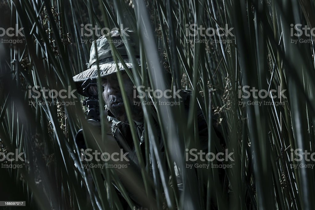 Camoflagued Soldier stock photo
