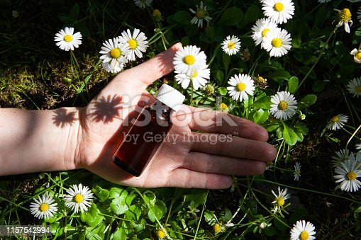 istock Camomile oil in glass bottle. 1157542994